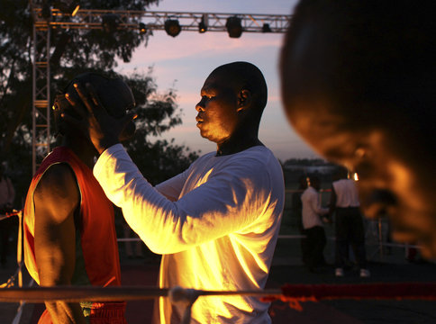 A trainer prepares a boxer before a kickboxing competition in Juba