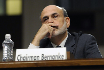 Bernanke listens during testimony at a Joint Economic Committee hearing on the economic outlook, on Capitol Hill in Washington