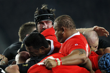 New Zealand All Blacks' Andrew Hore is caught in a scrum during their Rugby World Cup Pool A match against Tonga at Eden Park in Auckland