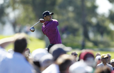 Tiger Woods tees off on the fourth hole in first round play on Torrey Pines North course during the Farmers Insurance Open PGA golf tournament in San Diego