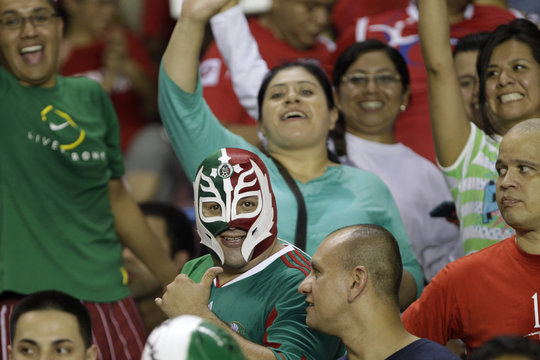 A Mexico supporter wearing a wrestling mask shows the thumbs up before their 2014 World Cup qualifying soccer match against Panama at the Rommel Fernandez stadium in Panama City