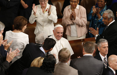 Pope Francis smiles as he arrives on the floor of the U.S. House of Representatives to address the U.S. Congress in Washington