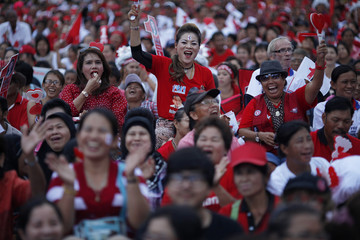 Supporters of Yingluck Shinawatra, sister of ousted premier Thaksin Shinawatra, gather for the last big pre-election rally of their Puea Thai party at a stadium in Bangkok