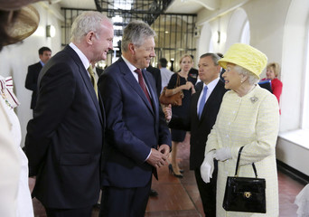 Britain's Queen Elizabeth talks to Northern Ireland's First Minister Robinson and Deputy First Minister McGuinness on a visit to Crumlin Road Gaol in Belfast