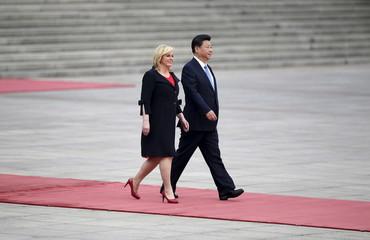 Croatia's President Kolinda Grabar-Kitarovic and China's President Xi Jinping attend a welcoming ceremony in Beijing