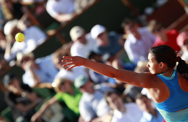 Bartoli of France serves to Schiavone of Italy during their semi-final match at the French Open tennis tournament at the Roland Garros stadium in Paris