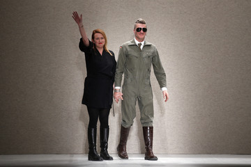Belgian designers An Vandevorst and Filip Arickx appear at the end of their A.F. Vandevorst Fall/Winter 2014-2015 women's ready-to-wear collection show during Paris Fashion Week
