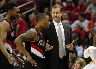 Portland Trailblazers Head coach Terry Stotts talks with guard Wesley Matthews and Damian Lillard during a timeout