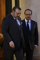 French President Francois Hollande accompanies Morocco's King Mohammed VI as he leaves after a meeting at the Elysee Palace in Paris