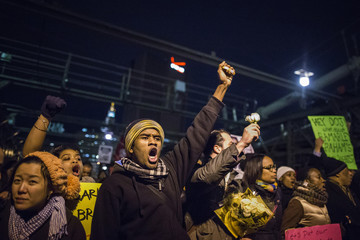Protesters, demanding justice for Eric Garner, cross the Brooklyn Bridge in New York City,