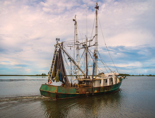 Shrimp fishing boat on Gulf of Mexico waters Florida coast