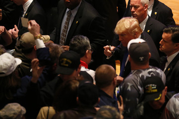 U.S. Republican presidential candidate businessman Donald Trump greets supporters after speaking at a veteran's rally in Des Moines