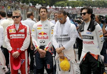 Formula one drivers observe a minute of silence in tribute to the victims of the Paris attacks, before the Brazilian F1 Grand Prix in Sao Paulo