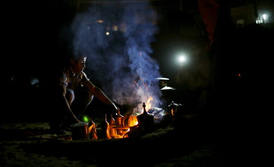 Bedouin Palestinian prepares coffee during a traditional wedding for Bedouin couple in the northern Gaza Strip