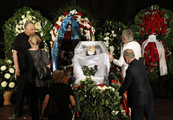 People mourn near the coffin of Russian poet Voznesensky during his funeral ceremony in Moscow