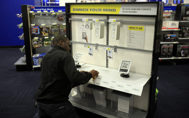 A Best Buy employee prepares the Nook eReader display at a Best Buy store in New York