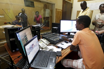 Senior staff at the Radio Publique Africaine work inside their broadcasting studio in Burundi's capital Bujumbura