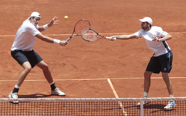 Isner and Fish of U.S. return the ball to Salamanca and Farah of Colombia during their Davis Cup doubles tennis match in Bogota