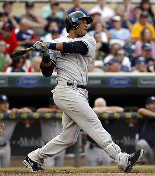 New York Yankees Robinson Cano watches his solo homerun against Minnesota Twins starting pitcher Scott Diamond in Minneapolis