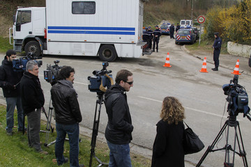 Members of the media line the road which leads to the house where four men suspected of belonging to the Basque separatist group ETA were brought in for questioning in Willencourt