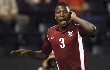 Qatar's Mohammed Kassola celebrates after scoring against Vietnam during the second round of the Asian qualifying match for the 2014 World Cup in Doha