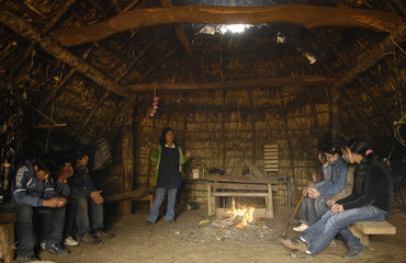 "Mapuche Indian children attend a lesson at a ""Casa Piedra"" public school near Tirua town"