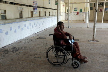 A patient in a wheelchair waits in the halls of Out Patient Departments (OPD) during a strike called by paramedics demanding for health allowance at the Jinnah Postgraduate Medical Centre (JPMC) in Karachi