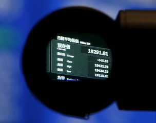 The Japan's Nikkei average is seen through a viewfinder of a video camera at the Tokyo Stock Exchange in Tokyo