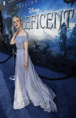 """Cast member Fanning poses at the premiere of """"Maleficent"""" at El Capitan theatre in Hollywood"""