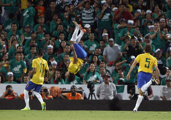 Brazil's Marcelo celebrates after scoring a goal against Mexico during their international friendly soccer match in Torreon