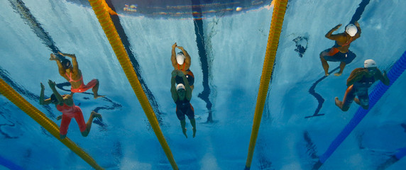 Lawrence from the U.S., Pedersen of Denmark and Watanabe of Japan swim in the women's 200m breaststroke final at the Aquatics World Championships in Kazan