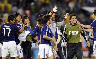 Japan's players celebrate their victory over Cameroon after their 2010 World Cup Group E soccer match at Free State stadium in Bloemfontein