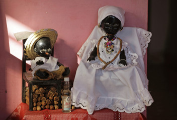 Elements used in Santeria rituals by Cuban spiritualist, fortune teller and witch Mayra, sit on a table of her home in Havana