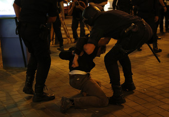 A protester is detained by Spanish police during a demonstration calling for the resignation of Spanish Prime Minister Mariano Rajoy, in Madrid