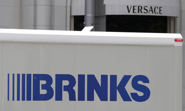 The logo of a Brinks truck is seen near the logo of  a Versace store on Rodeo Drive in Beverly Hills