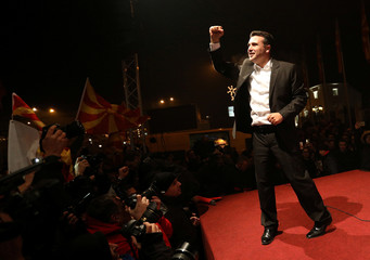 The leader of the opposition Social Democratic Union of Macedonia (SDSM) Zoran Zaev celebrates with supporters during parliamentary elections in Skopje