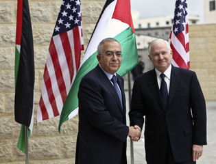 Palestinian Prime Minister Fayyad shakes hands with U.S Defense Secretary Gates upon his arrival to Ramallah