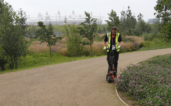 A landscape gardener works at the Olympic Park in Stratford, the location of the London 2012 Olympic Games, in east London