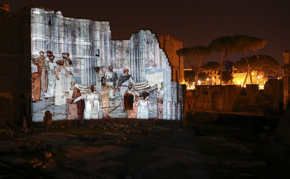 An illustration depicting life in ancient Rome is projected on the walls of the Forum of Augustus in Rome