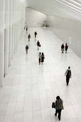 People walk through The World Trade Center's underground passageway in lower Manhattan in New York