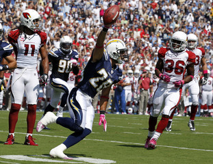 San Diego Chargers safety Gregory celebrates his first quarter interception as Arizona Cardinals wide receiver Fitzgerald and running back Stephens-Howling look on during their NFL football game in San Diego