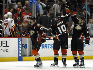 Anaheim Ducks center Todd Marchant congratulates right wing Corey Perry for Perry's game-winning goal in the overtime period against the Calgary Flames in their NHL game in Anaheim