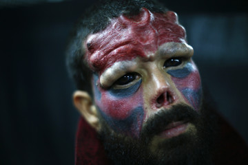 Body modification artist known as Red Skull poses for a picture at Venezuela Expo Tattoo in Caracas