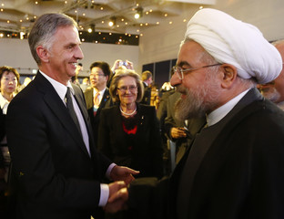 Swiss President Burkhalter greets Iran's President Rouhani  at World Economic Forum in Davos
