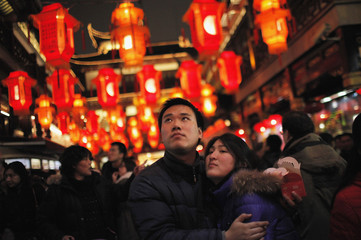 A couple looks at lanterns ahead of the Lantern Festival at Yu Yuan Garden in downtown Shanghai