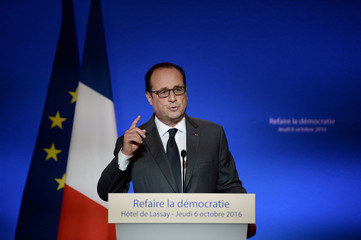 French President Francois Hollande delivers his speech during a symposium on re-founding democracy (Refaire la democratie) at the Hotel de Lassay in Paris