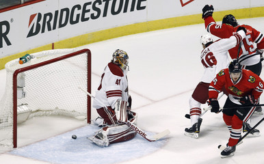 Chicago Blackhawks' Brunette reacts after scoring on Phoenix Coyotes goalie Smith during their NHL Western Conference quarter-final playoff in Chicago