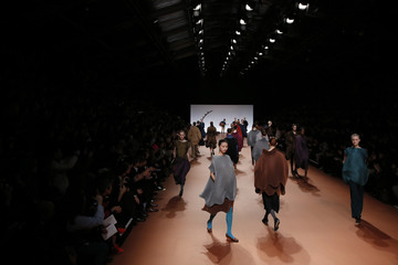 Models present creations by Japanese designer Yoshiyuki Miyamae as part of his Fall/Winter 2014-2015 women's ready-to-wear collection for fashion house Issey Miyake in Paris