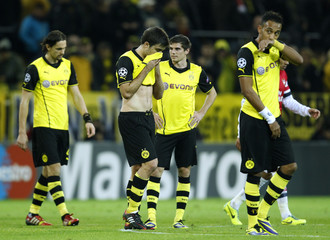Borussia Dortmund players react after losing to Arsenal in Champions League soccer match in Dortmund