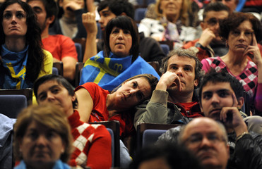 Spanish supporters of Ferrari Formula One driver Fernando Alonso watch the Brazilian F1 Grand Prix on a big screen in Oviedo
